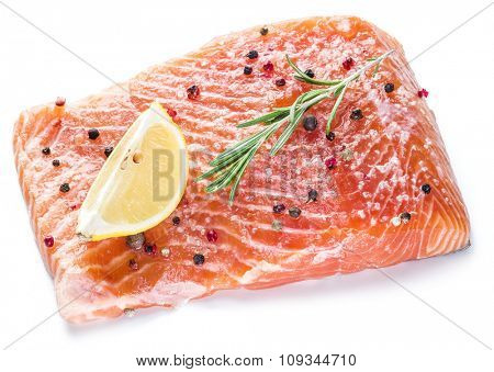 Salted salmon fillet on the white background. Cooking process.