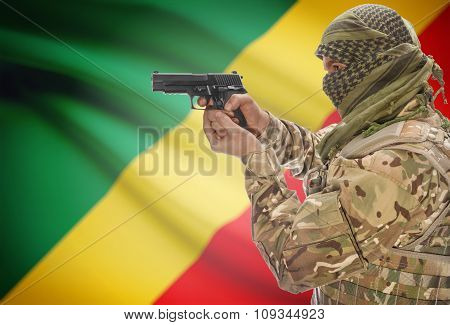 Male In Muslim Keffiyeh With Gun In Hand And National Flag On Background - Congo-brazzaville