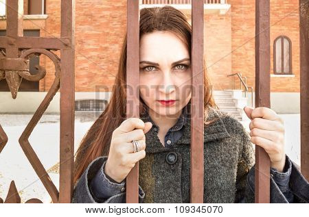 Sad and Depressed Woman Behind Bars In Mental Hospital Sanatorium