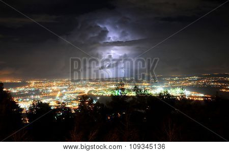 Lightning storm in Haifa Israel: Night cityscape with strong lightning majestic view on coastal town