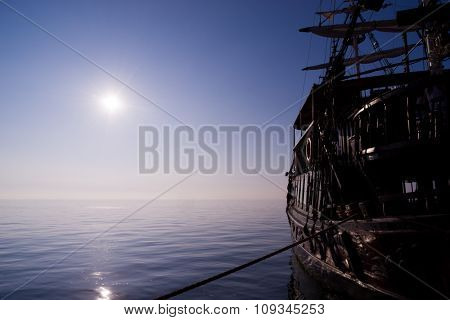 Sailboat pirate ship  against a beautiful landscape