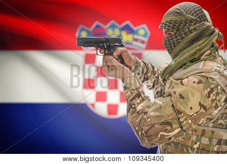 Male In Muslim Keffiyeh With Gun In Hand And National Flag On Background - Croatia