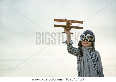 Little boy with wooden airplane