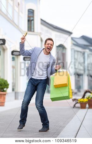 Emotional man with shopping bags