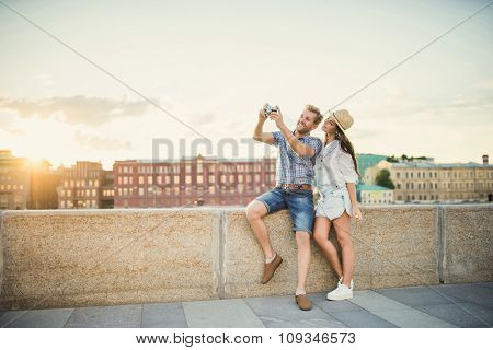 Young tourists on the embankment