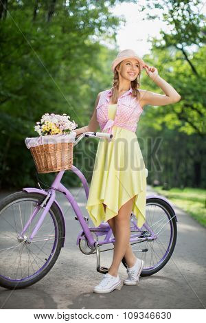 Young girl on a bicycle outdoors