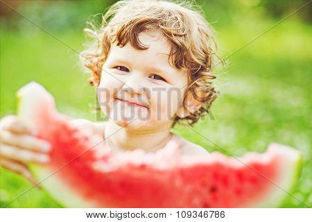 Happy Child Eating Watermelon In Summer Park. Instagram Filter.