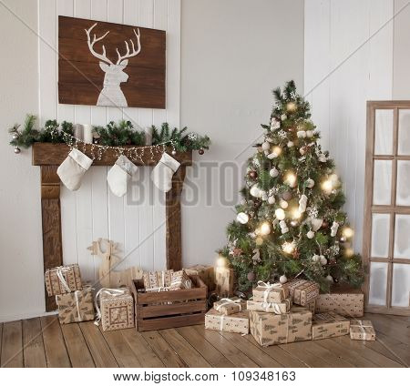 Interior living room with a Christmas tree and decorations.
