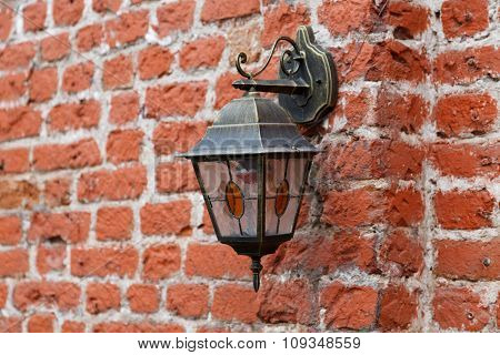 Vintage Lantern On Old Brick Wall