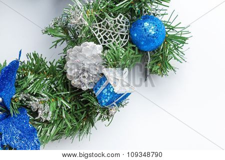 Christmas fir tree branch with golden decoration.