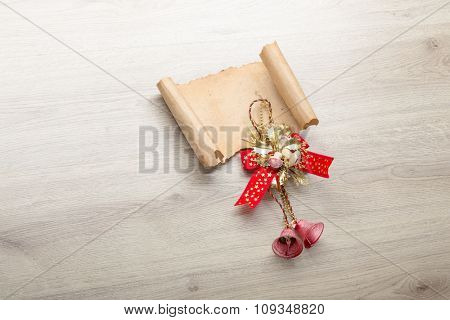 Christmas card on wooden top with christmas ornaments.
