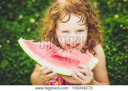 Happy Little Girl Eating Watermelon In Summer Park. Instagram Filter.