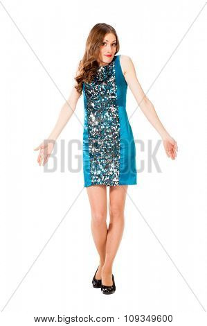 Young slim pretty woman in blue dress with sequins shrugs and spreads hands isolated on white background