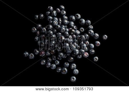 Heap of blueberries on black background from above
