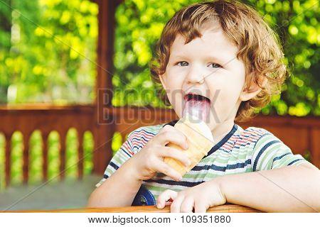 Happy Child Eating Ice-cream In Summer Park.