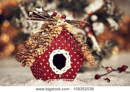 Vintage Christmas greeting card with small birdhouse