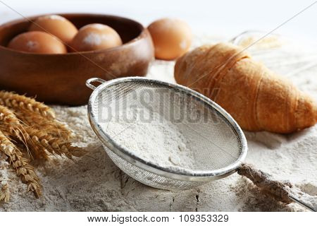 Preparing croissant on white flour background