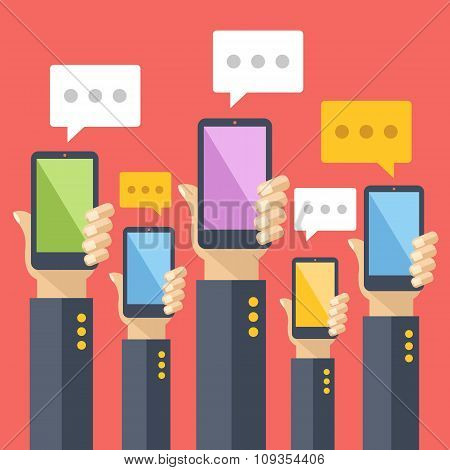 Hands hold smartphones with chat bubbles. Instant messaging, texting, sms. Flat vector illustration