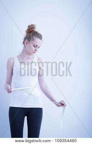 Slim Girl Measuring Her Waist