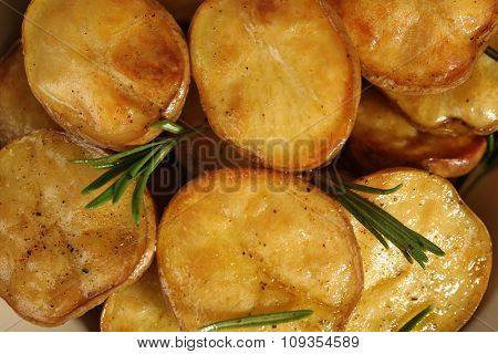 Delicious baked potato with rosemary close up