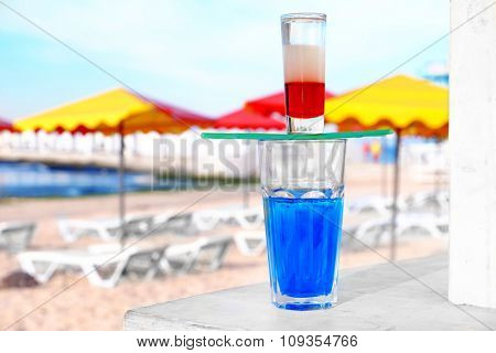 Alcohol cocktails on beach bar counter, close up