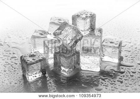 Melting ice cubes on grey background, close up