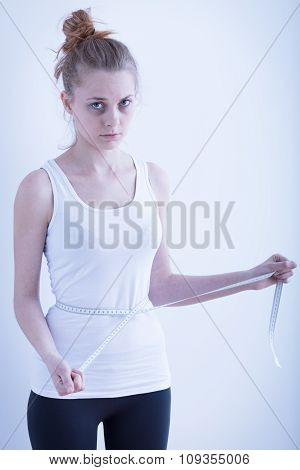 Anorexic Girl With Measuring Tape