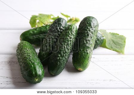 Cucumbers on light wooden background