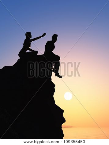 Silhouettes of men and women on the mountain.