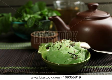 Homemade Green tea ice-cream on bamboo mat, on wooden background