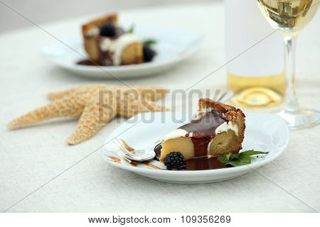 Delicious cake under chocolate glaze with blackberry