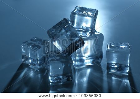 Unimprovable ice cubes under blue light, close up