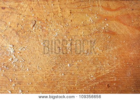 Old wooden cutting board with crumbs background