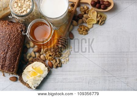 Healthy breakfast with bread, honey, nuts. Country breakfast concept