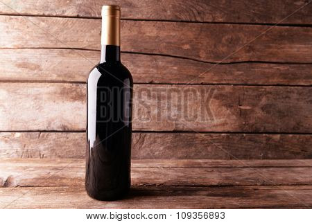 Bottle of red wine on wooden table