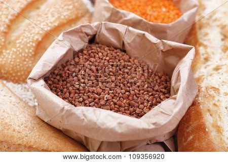 Mixed breads and grains background, close up