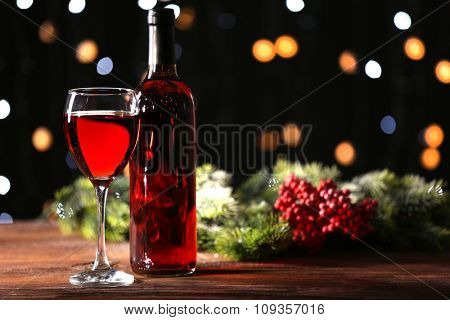 Wine glass with bottle on wooden table