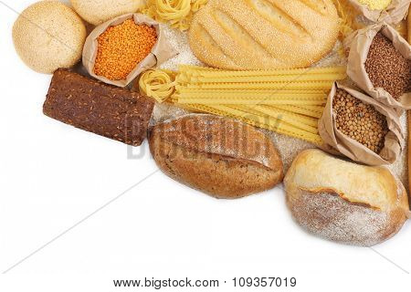 Composition of mixed breads, macaroni and grains on white background