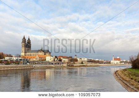 Skyline of Magdeburg on the Elbe river with cathedral in foreground