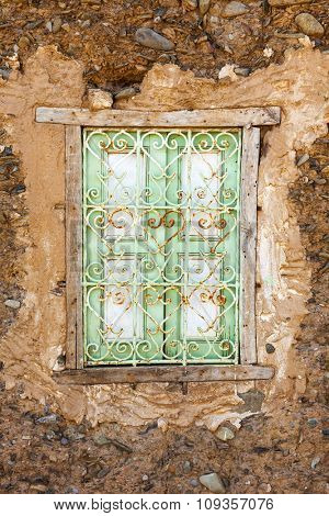 Ornate window in moroccan adobe house, Oued Nfis Valley