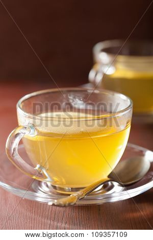 hot lemon ginger tea in glass cup