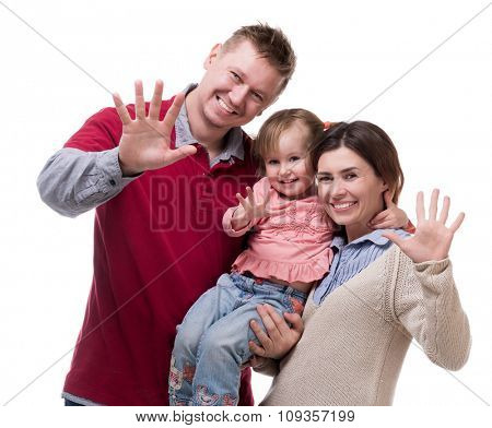 couple and their little daughter with palms up isolated on white background