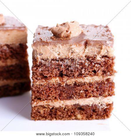 Sweet chocolate cakes isolated on white background