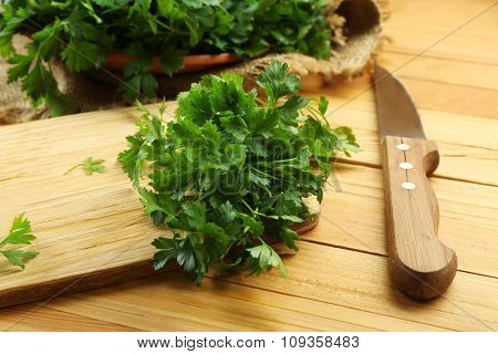 Fresh parsley on wooden cutting board