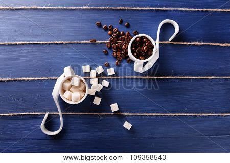 Creative musical note on blue wooden background