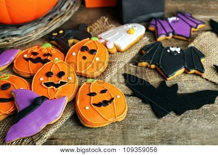 Creative cookies for Halloween party on wooden table, close up