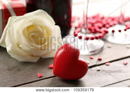 Setting of romantic decorations, on wooden background