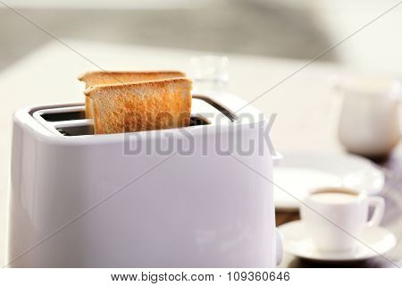 Served table for breakfast with toast and coffee, on blurred background, close-up