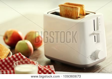 Served table for breakfast with toast, milk and honey, close-up