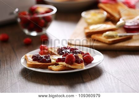 Served table for breakfast with toast and jam, close-up